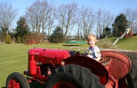 Tractor in the play area at Wood Farm